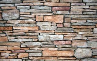 Decorative wall from irregular stone tiles