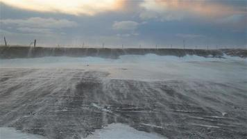 Arctic wasteland hurricane gale force wind scoured earth rocky ground fence video