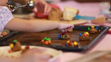 hand of a little child toddler makes chocolate cookies video
