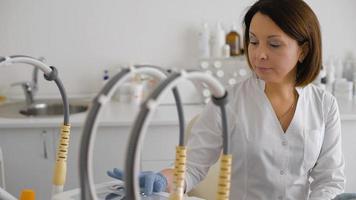 Female doctor setting up medical machine