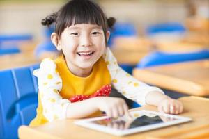 smiling kid using tablet  or ipad
