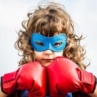 Superhero kid. Girl power concept photo
