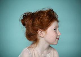 Portrait of beautiful redhead little girl photo
