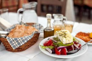 Greek salad with country bread and home made white wine photo
