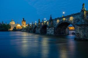 Charles bridge in Prague during dawn.