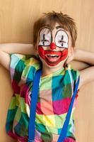 Little boy in clown facepaint
