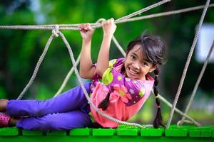 Happy little asian girl on the playground photo
