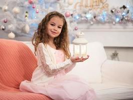pretty little girl with flashlight photo