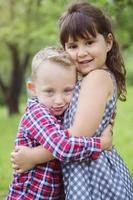 image of two happy children having fun in the park photo