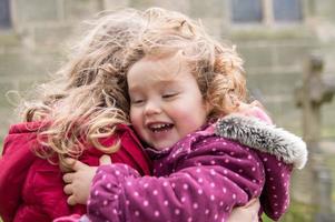 Sister hug photo