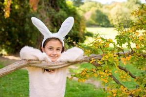 Little girl at autumn  with rabbit ears on her head