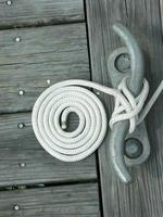 White Rope Coiled on Wooden Dock photo
