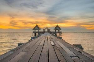 Landscape of Wooded bridge pier between sunset. Summer travel in