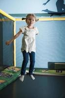 Young girl in mid air on trampoline