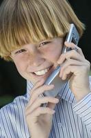 Boy with mobile phone, smiling