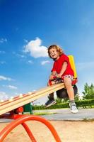 Young boy playing on a seesaw