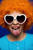 Fancy young lady with party wig photo