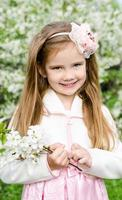 Portrait of adorable smiling little girl photo