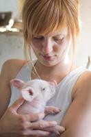 Girl and piglet photo
