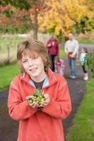 Boy posing with acorns photo