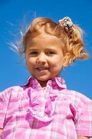 Close portrait of little girl in pink photo
