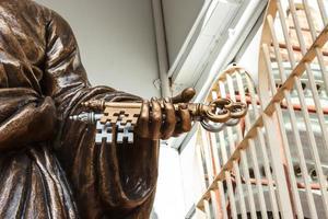 The keys of heaven in Saint Peter hand. photo