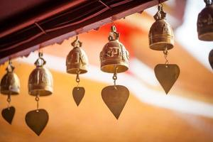 small bell hanging under the temple roof
