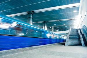 blue moving train with staircase photo