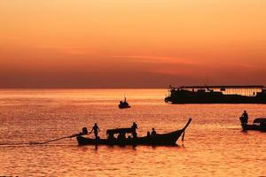 long tail boats at sunset  Koh Lipe