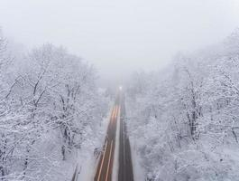 snowstorm, slick roads and lots of traffic in evening city