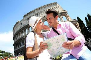 Couple in love looking at map before visiting Colisée photo