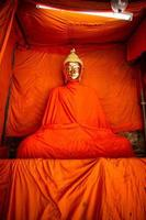 Golden Buddha covered with saffron yellow