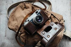 Old camera in bag, vintage photo grunge design component