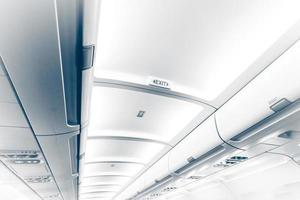 long ceiling in airplane with exit sign
