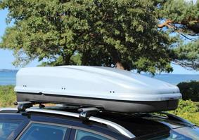 Roof box on car with railing photo