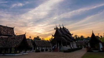 Time lapse -Twilight at Wat Ton Kain, Old wooden temple in Chiang Mai Thailand, They are public domain or treasure of Buddhism.(zoom) video