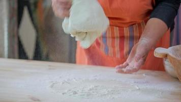 Woman kneading the dough to make a fresh bread