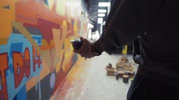 Graffiti artist painting on the wall, interior video