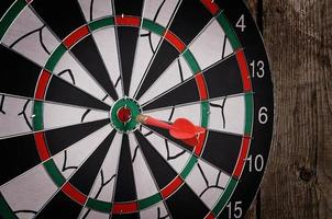 Darts on a wooden background photo