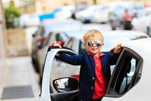 little boy travel by car in the city