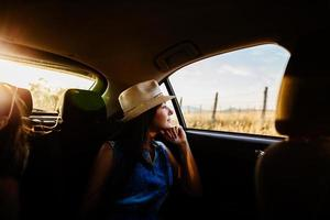 woman travel by car with sunlight and picturesque photo