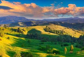 Colorful summer sunrise in the Carpathian village