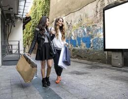 Two girls talk and walk photo