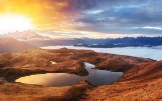 Sunset on mountain lake Koruldi. Upper Svaneti, Georgia, Europe.