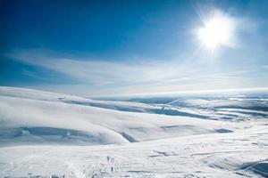 Large snow-covered fields under the sun