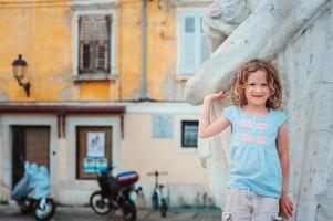 ourist child girl walking on streets of Piran, Slovenia
