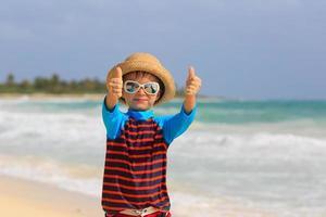little boy thumbs up on summer beach