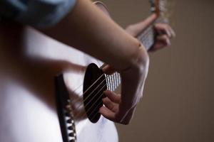 Guitarist hands close up photo