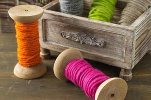 Spools of colorful wool yarn photo