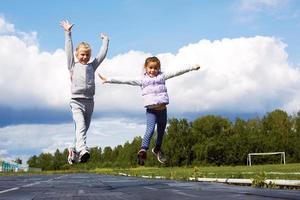girls jumping in the stadium photo